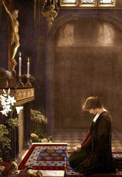 Woman praying before Crucifix